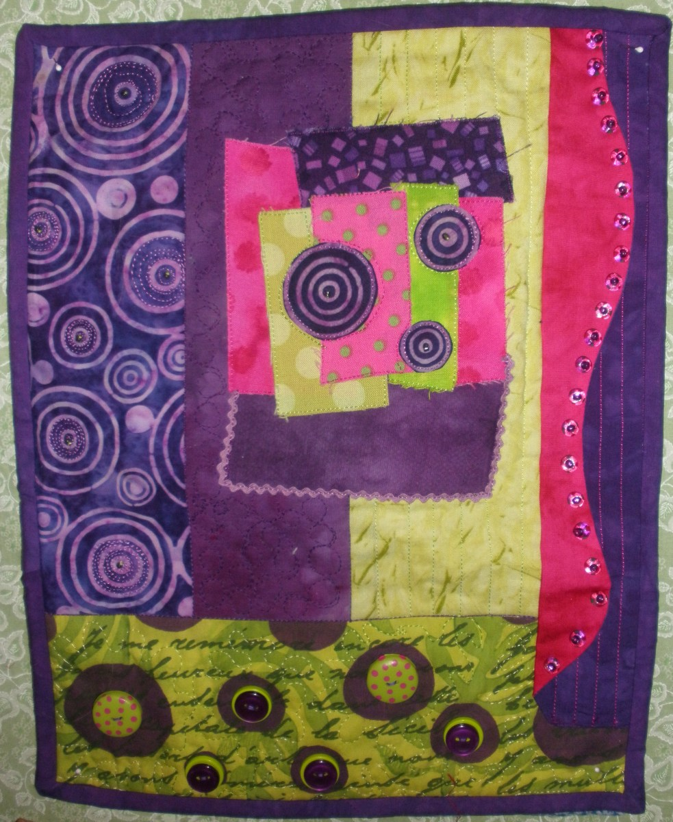 Small art quilts made up this quilt exchange.