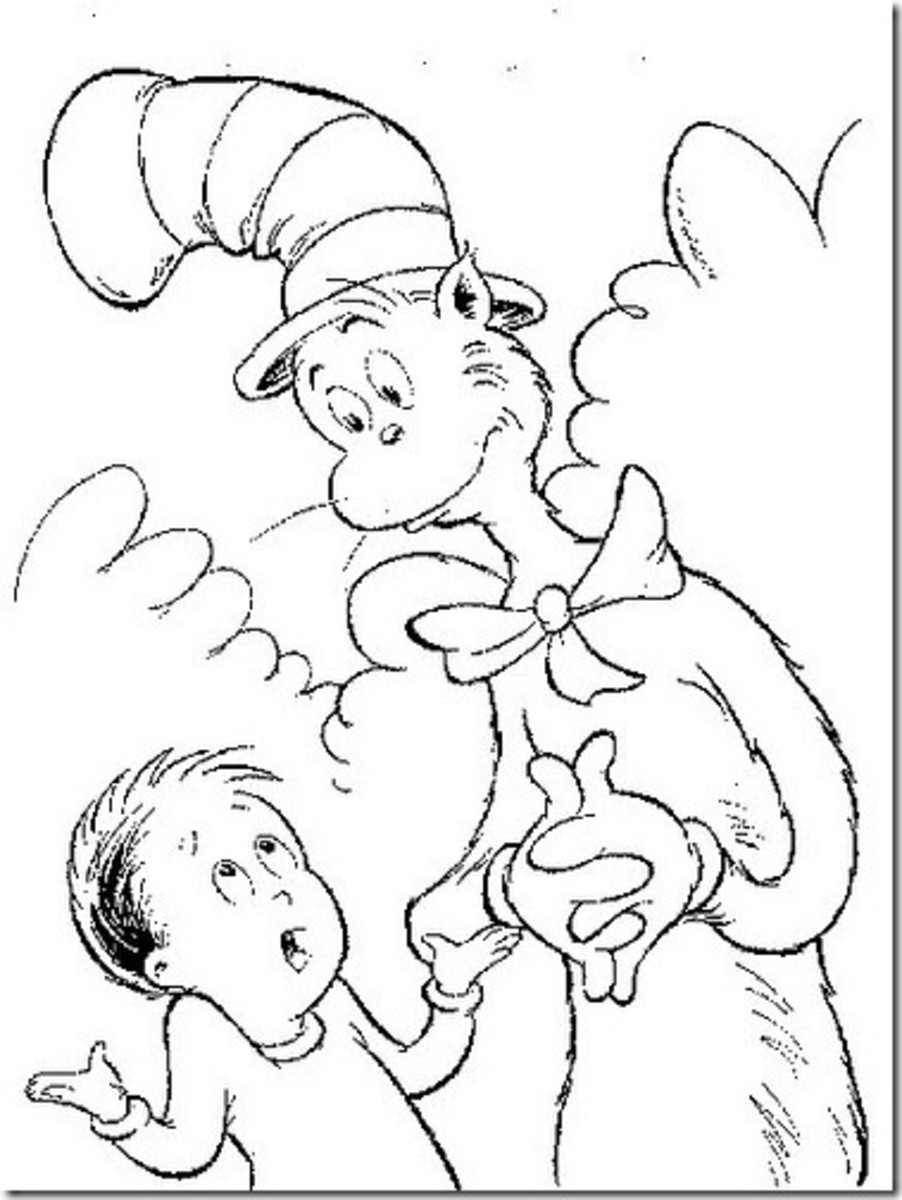 boy talking to cat in the hat