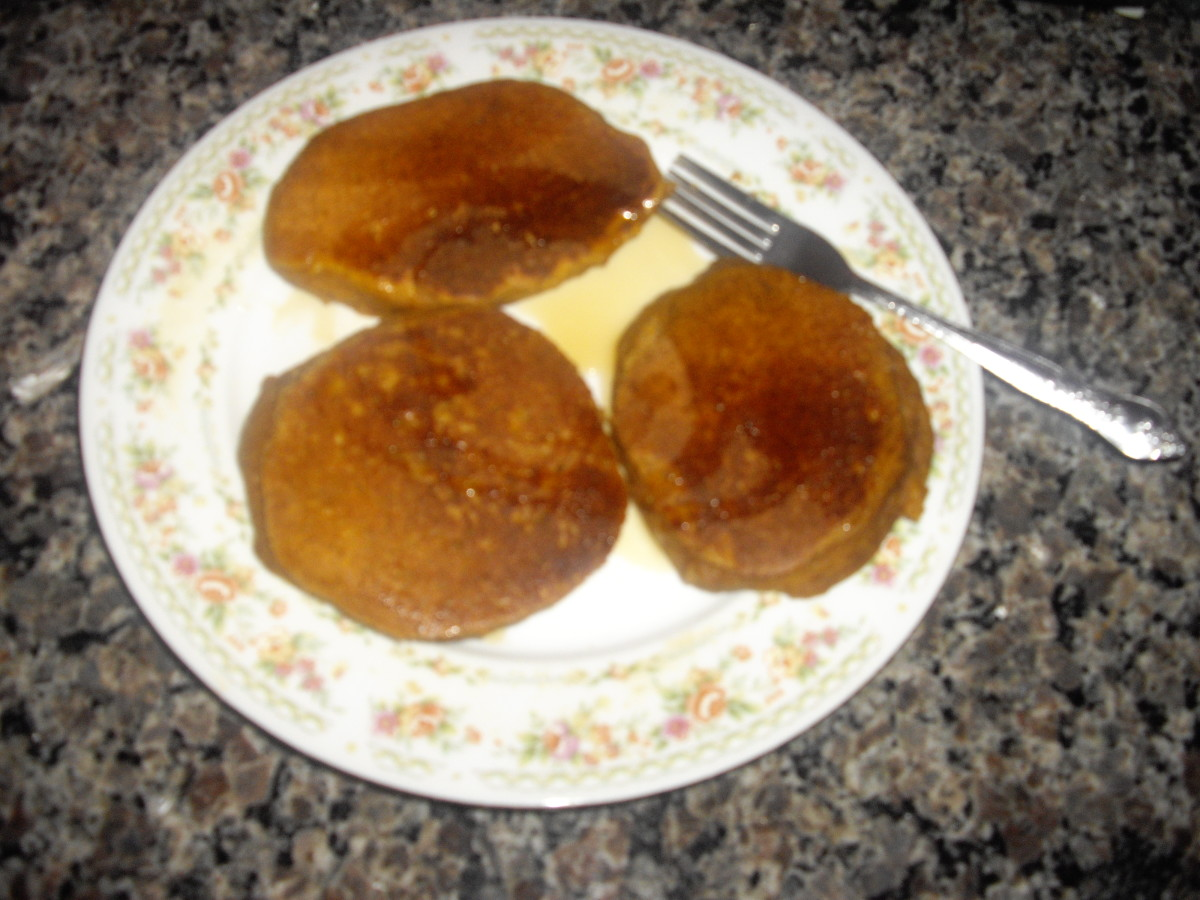These are my completed pancakes, with pure maple syrup drizzled over them