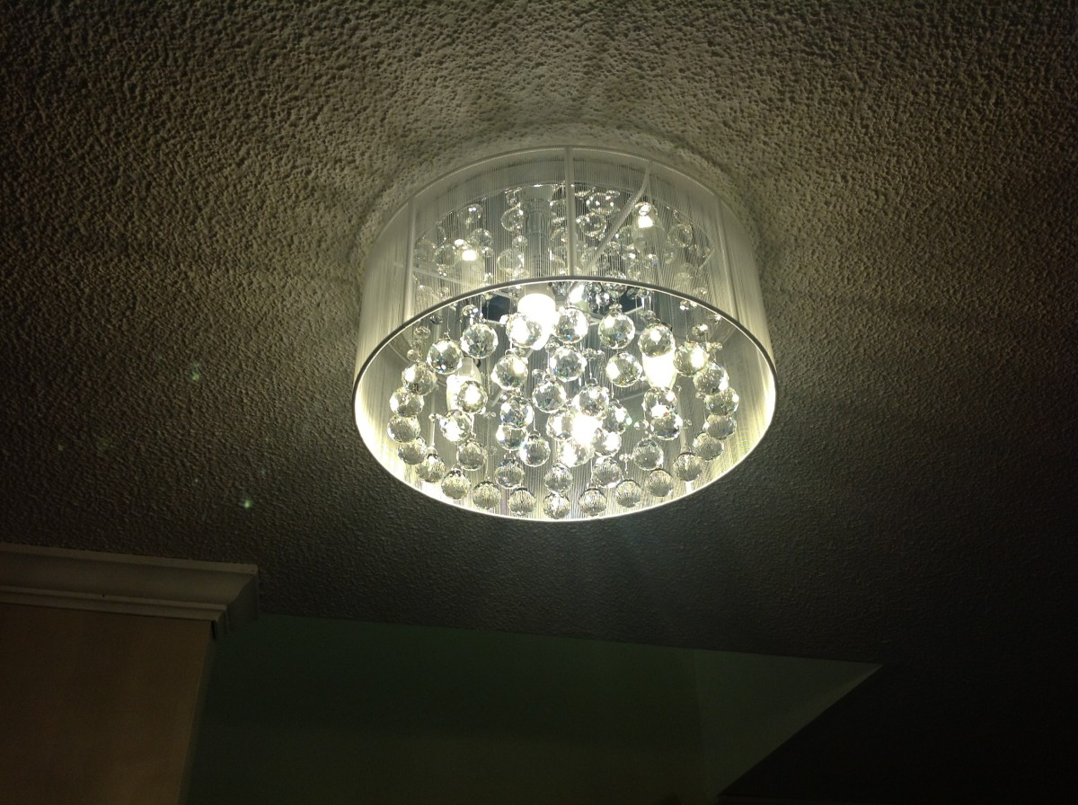 Just highlighting the new flush mount chandelier I ordered from Overstock.com. I bought 4 LED bulbs from Home Depot and it is bright let me tell you! Love it! The crystals are real glass and are heavy. It is worth every penny spent.