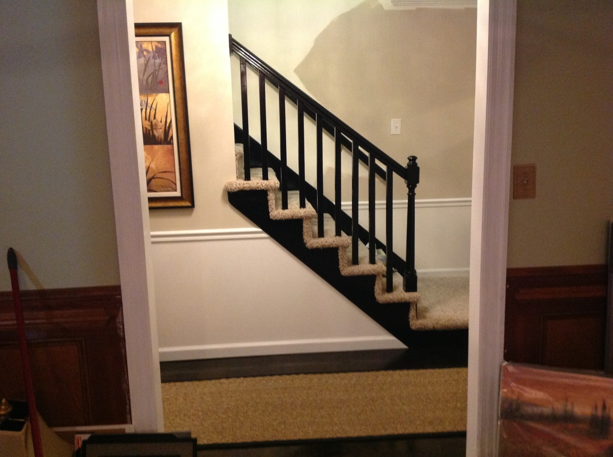 I painted the stair railings with high gloss black paint and love how it looks. Now, the carpet will be another hub entirely in itself because we have lots of it and me wants it all gone! The seagrass runner is from Overstock.com for those interested