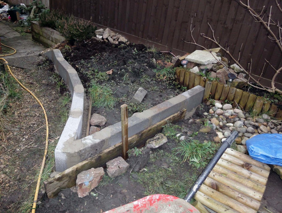 New retaining wall in friend's garden built for raised vegetable plot, to be back filled with soil once the wall has set firm.