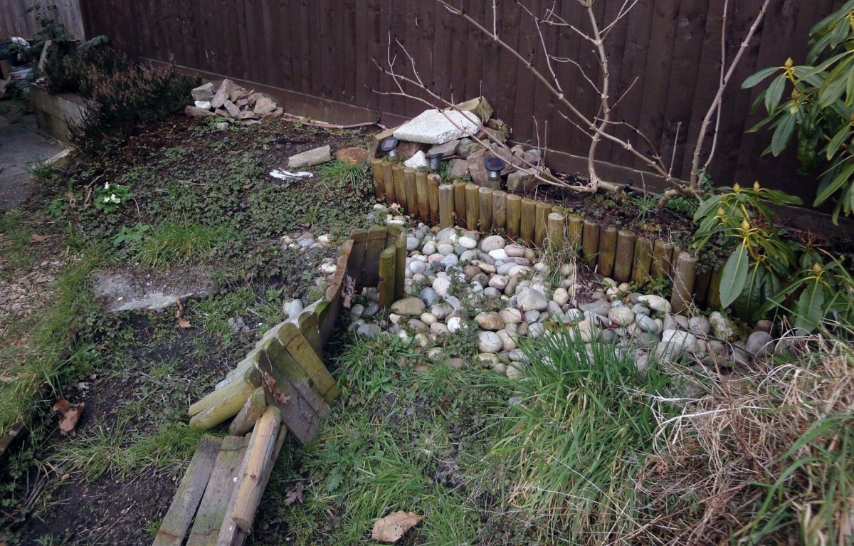 Clearing part of a friend's garden ready for building a small retaining wall for raised vegetable plot.