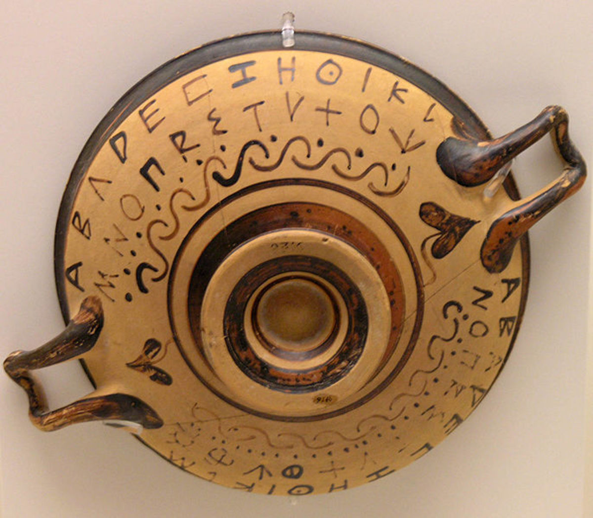 Early Greek alphabet painted on an Attic cup.