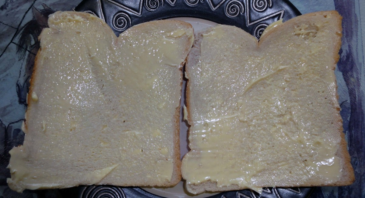 Buttering the bread with margarine