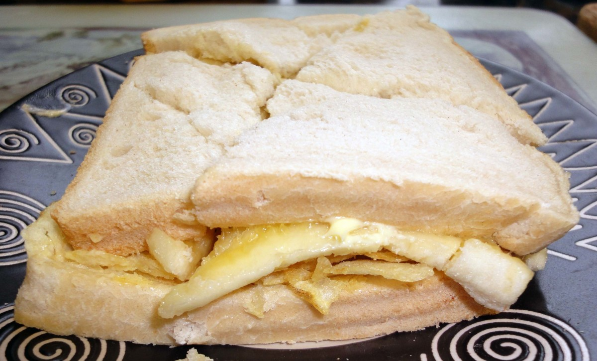 Cutting the crisp and banana sandwich into quarters