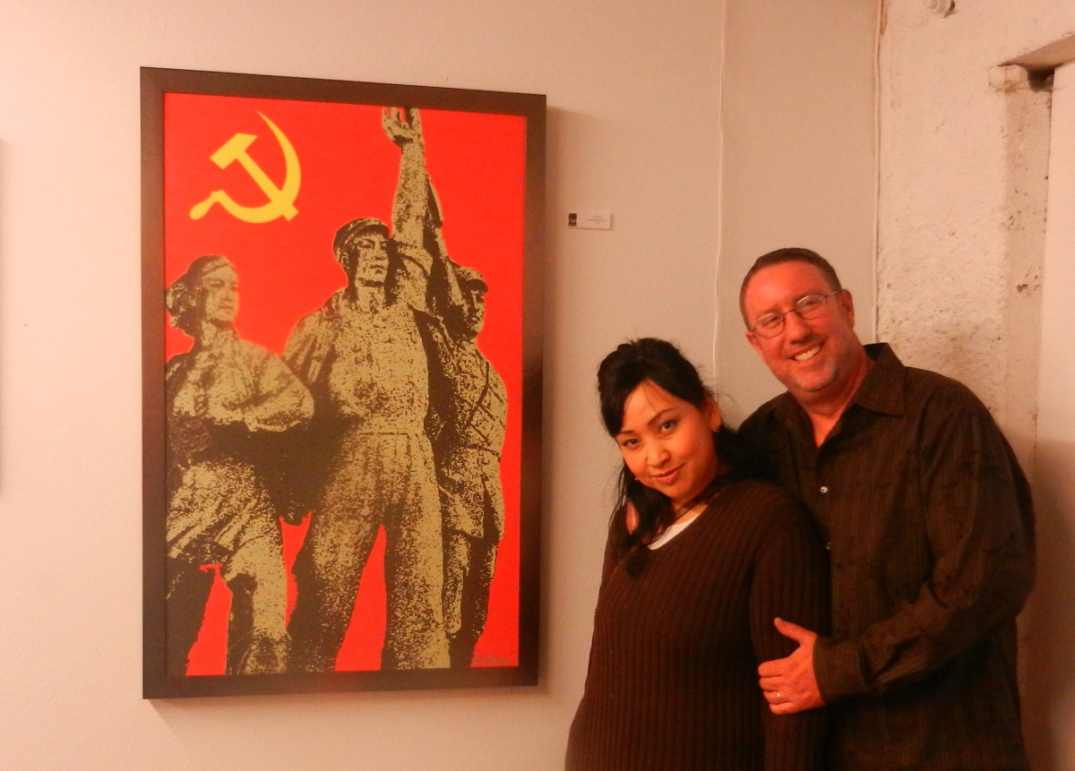 Al Heuer and his wife, Silvia, in front of my favorite piece, People's Revolution II.