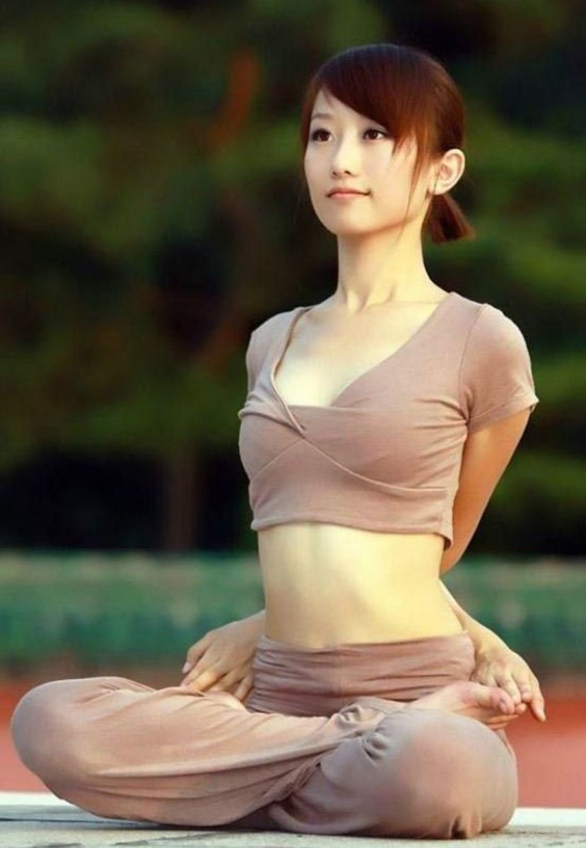 Japanese woman in Japan doing a yoga pose.