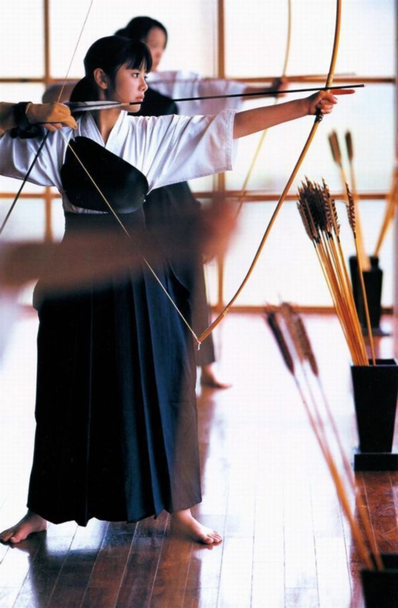 Japanese woman doing zen archery. This is mostly a spiritual discipline.