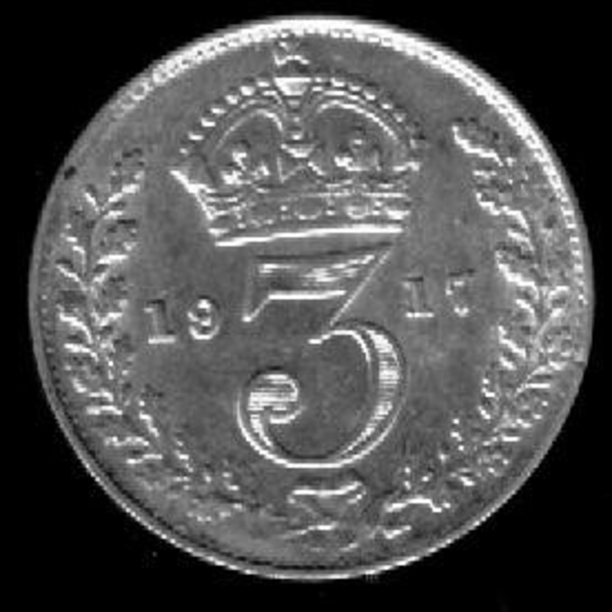 A silver British 3 pence coin