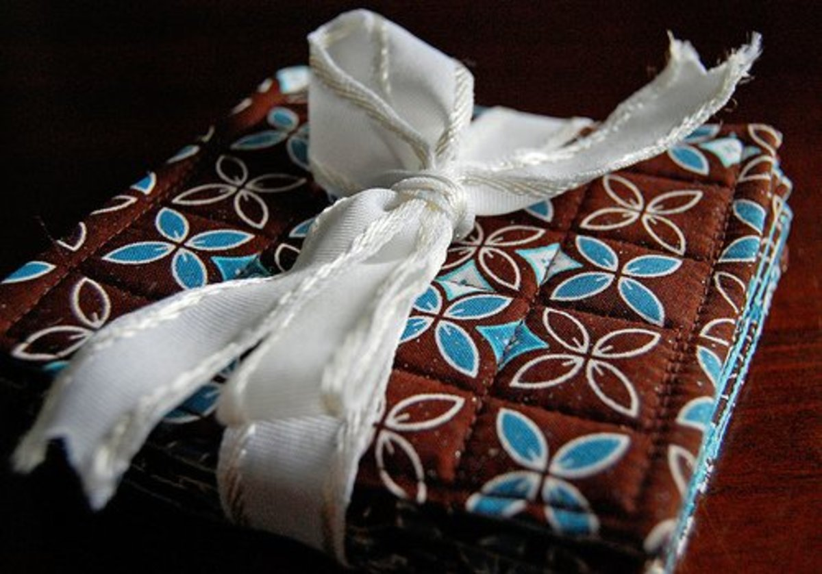 Fabric coasters. A ribbon is a simple way to tie up a set of coasters to give as a gift.