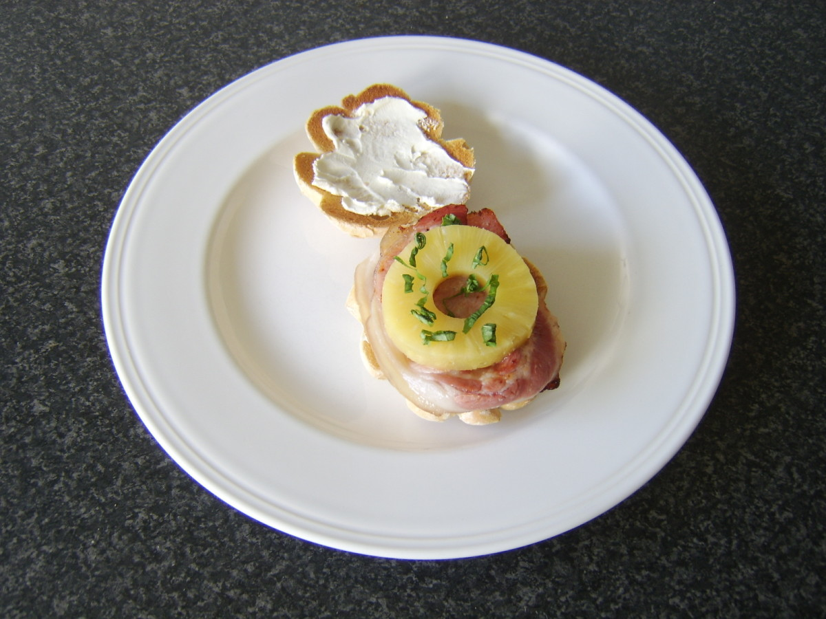Middle Bacon and pineapple are added to a toasted bread roll, spread with cream cheese