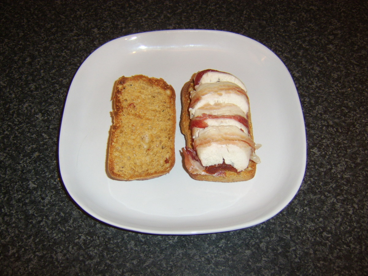 Chicken breast stuffed with sun dried tomatoes, wrapped in pancetta and served as a sandwich in a sun dried tomato ciabatta roll
