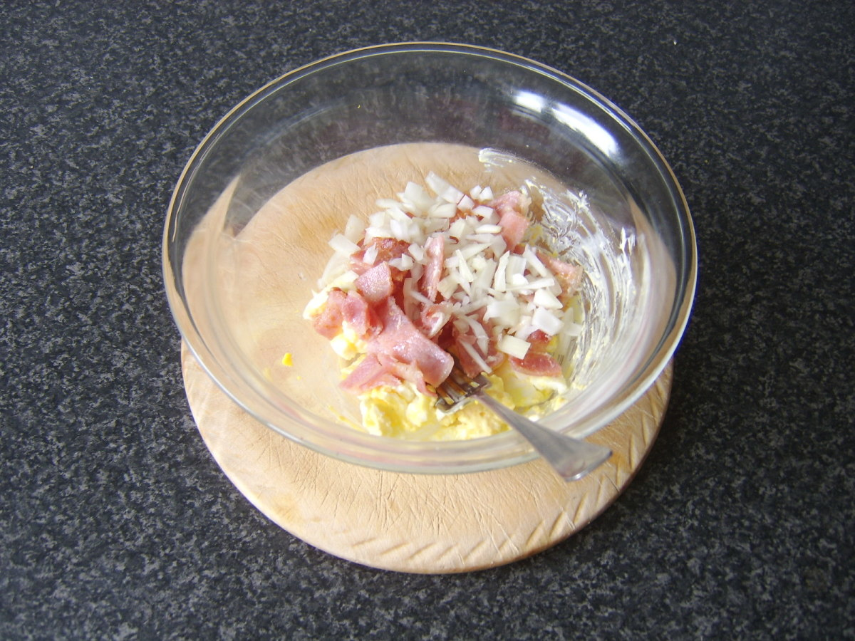 Bacon and onion are added to and stirred through the egg mayo
