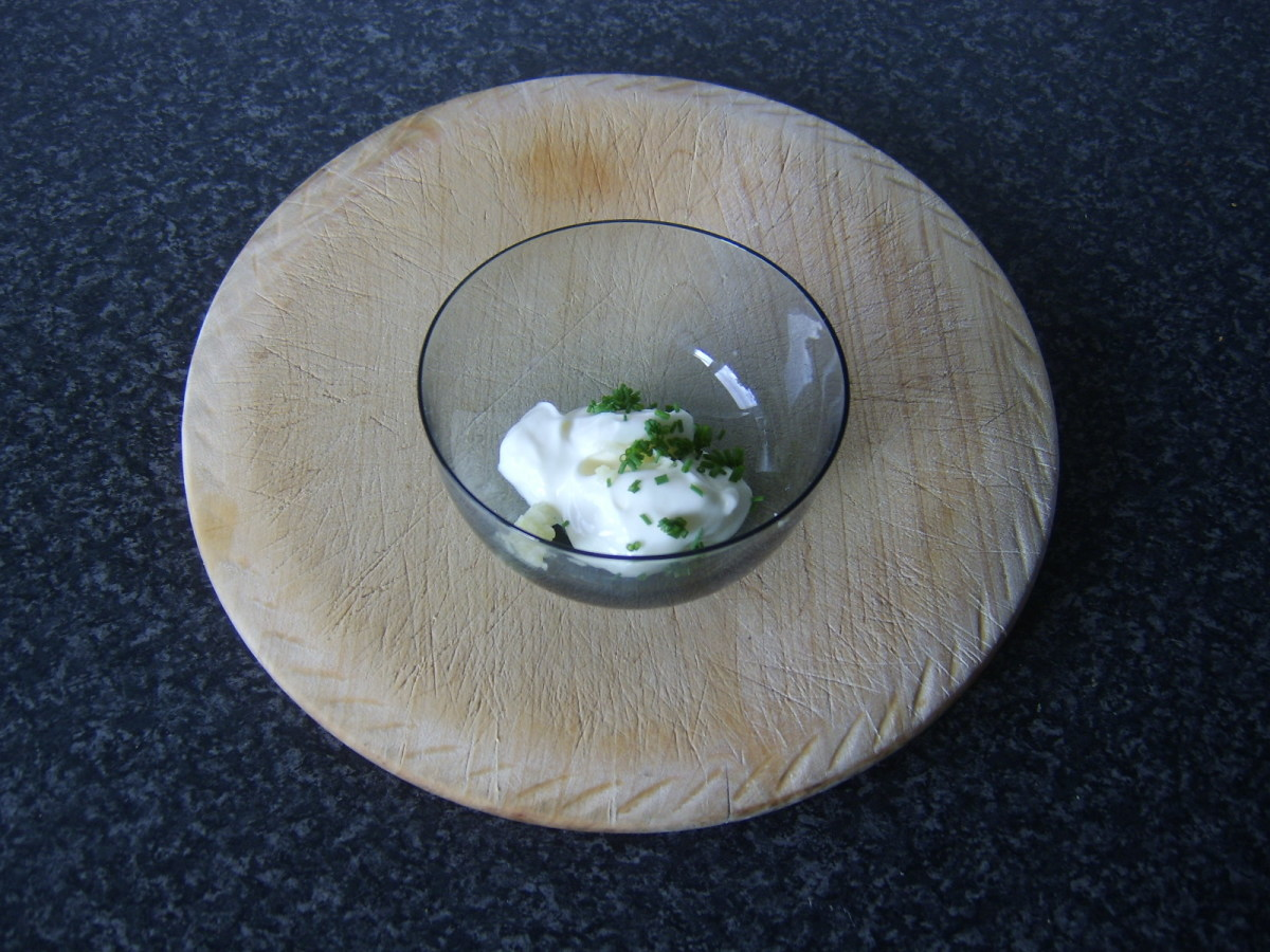 Mayo, garlic and chives are combined in a small bowl