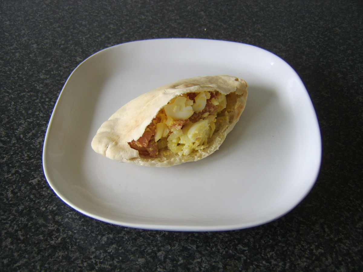 Chopped bacon, hard boiled egg and onion are mixed with mayo and made to fill a pitta bread pocket