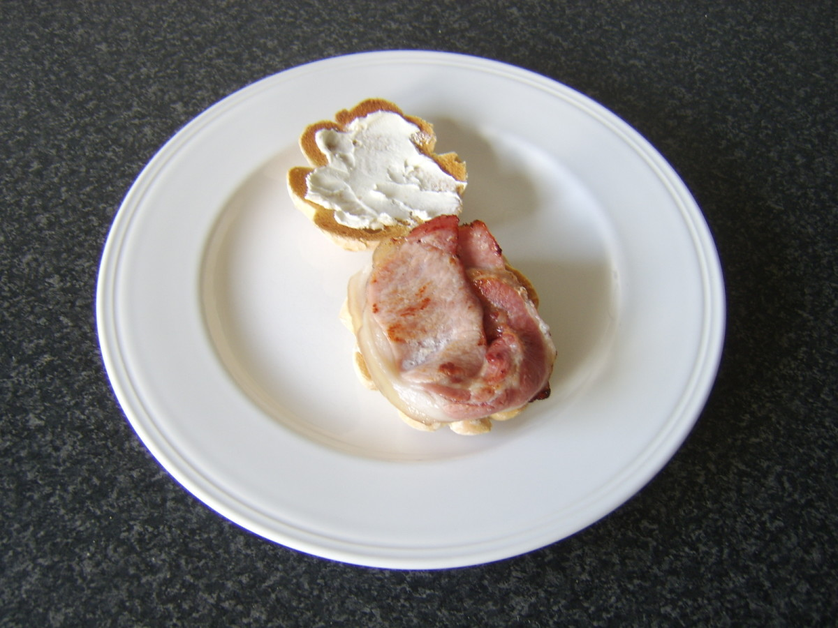 Bacon is added to the bottom half of the roll