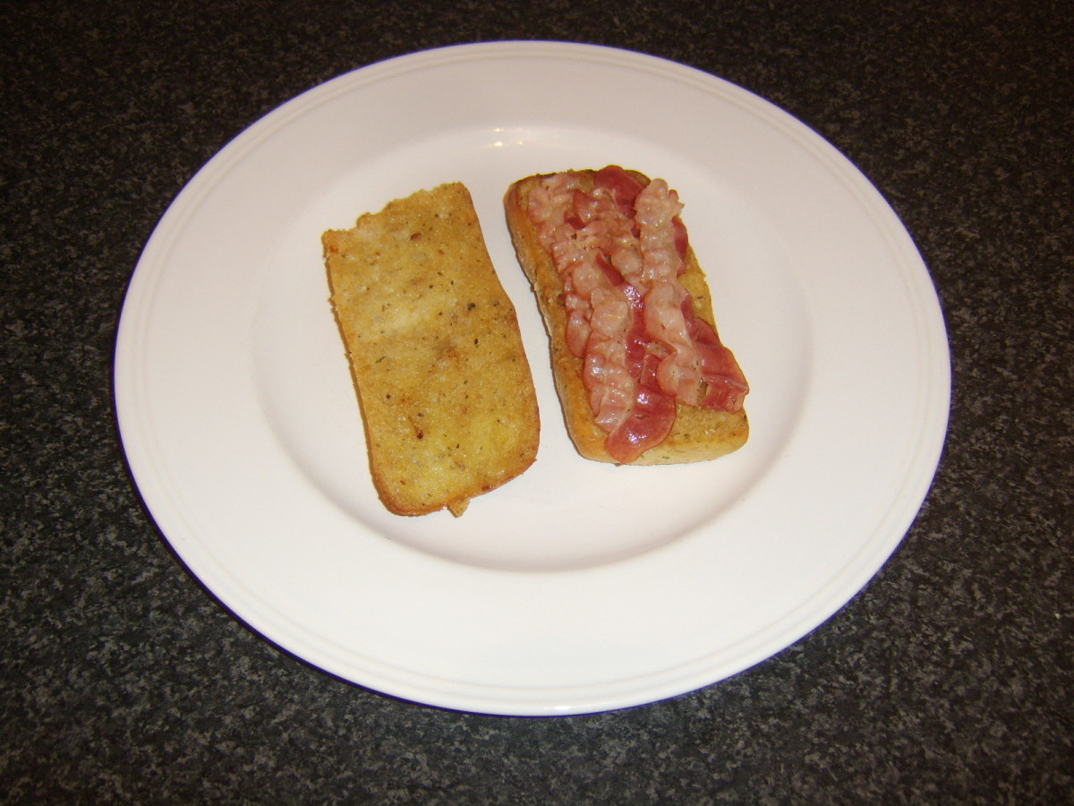 Pancetta laid on bottom half of ciabatta