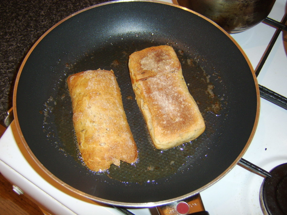 Frying ciabatta halves in bacon juices
