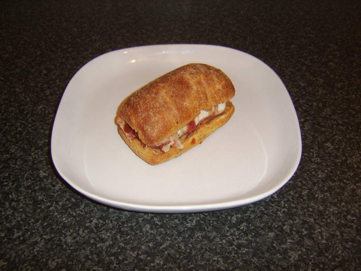 Pancetta wrapped stuffed chicken breast ciabatta roll sandwich