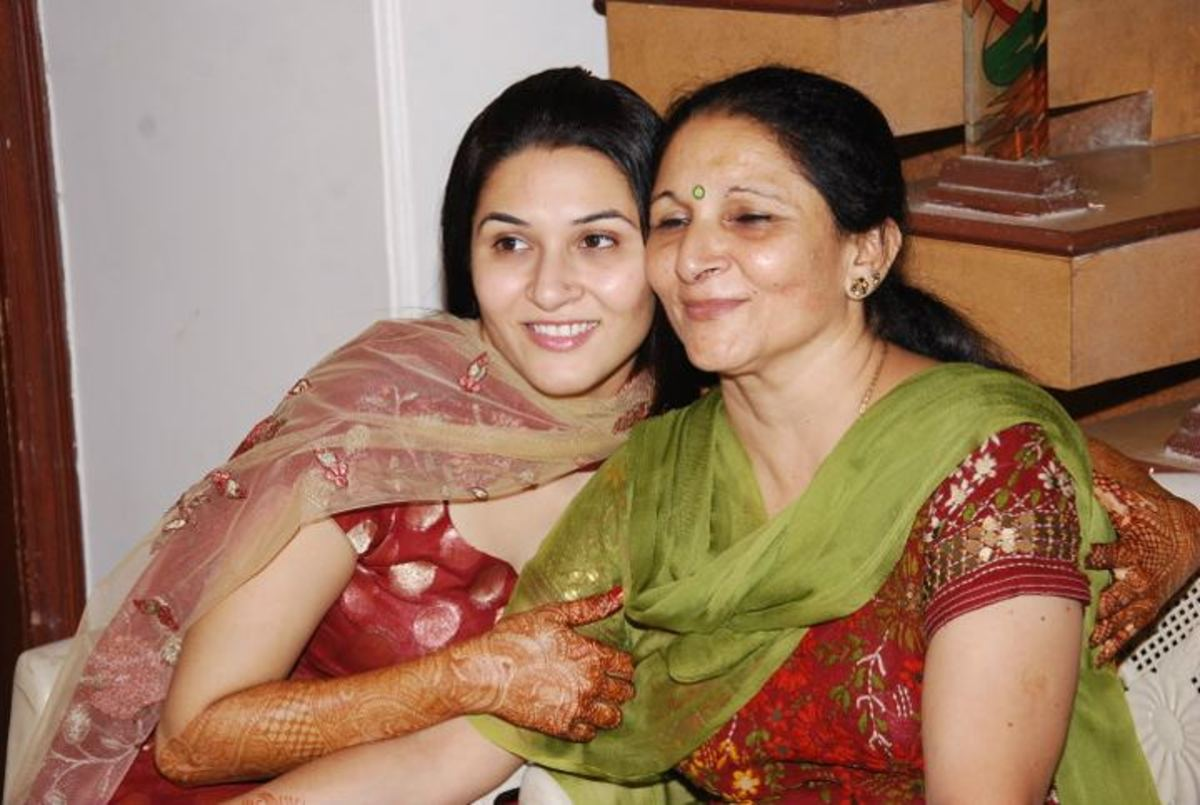 my daughter and her mom on the occasion of one of the functions during her marriage-the chuda ceremony.