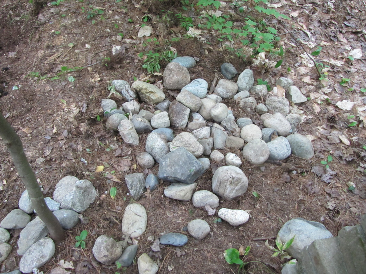 Accumulating the rocks - when I take my daily walk, I always bring back a rock or two that I find along the way.