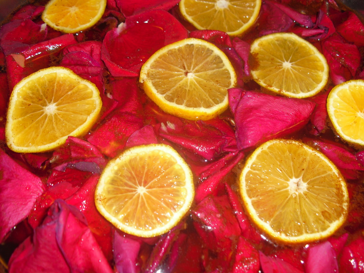 create your own fragrance blend of essential oils with petals and citrus slices in a room freshener.