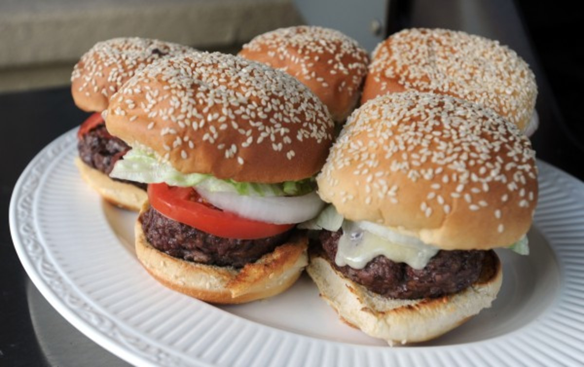 Grilling out hamburgers is about American as you can get. Add delicious hand cut french fries and a cold watermelon and you have the perfect meal.