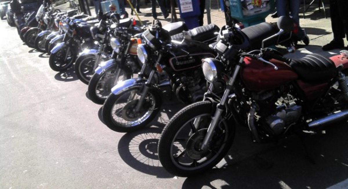 A row of inexpensive classic and vintage Japanese motorcycles in Portland, Oregon.