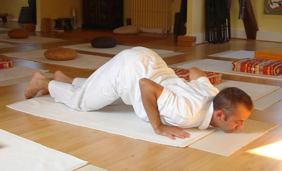 A few yoga postures are a part of the pain free program, as well a stretches and strengthening exercises. This posture is modified with the head down to relax the neck and shoulder muscles.