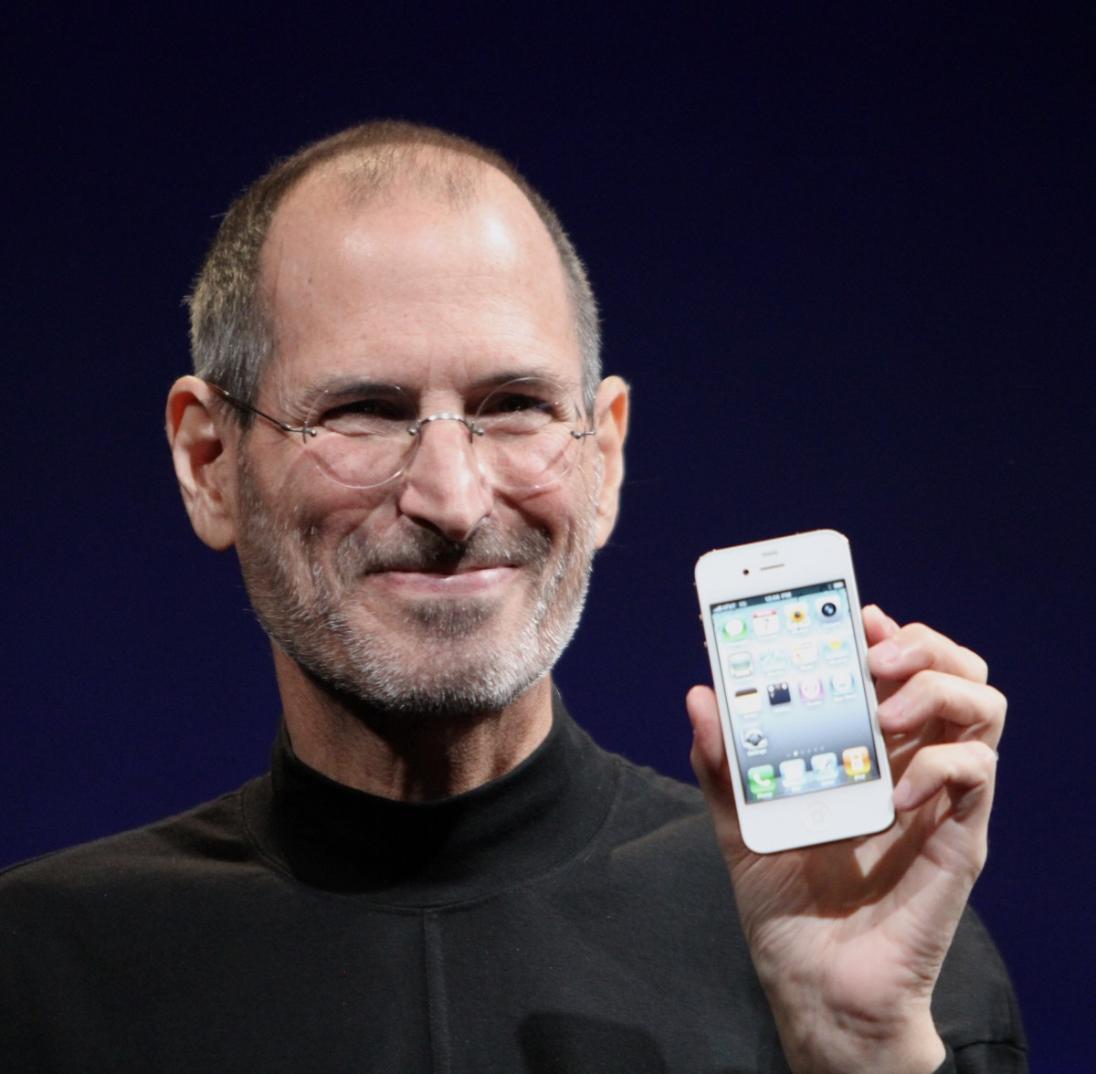 Steve Jobs holding the futuristic iPhone 4.