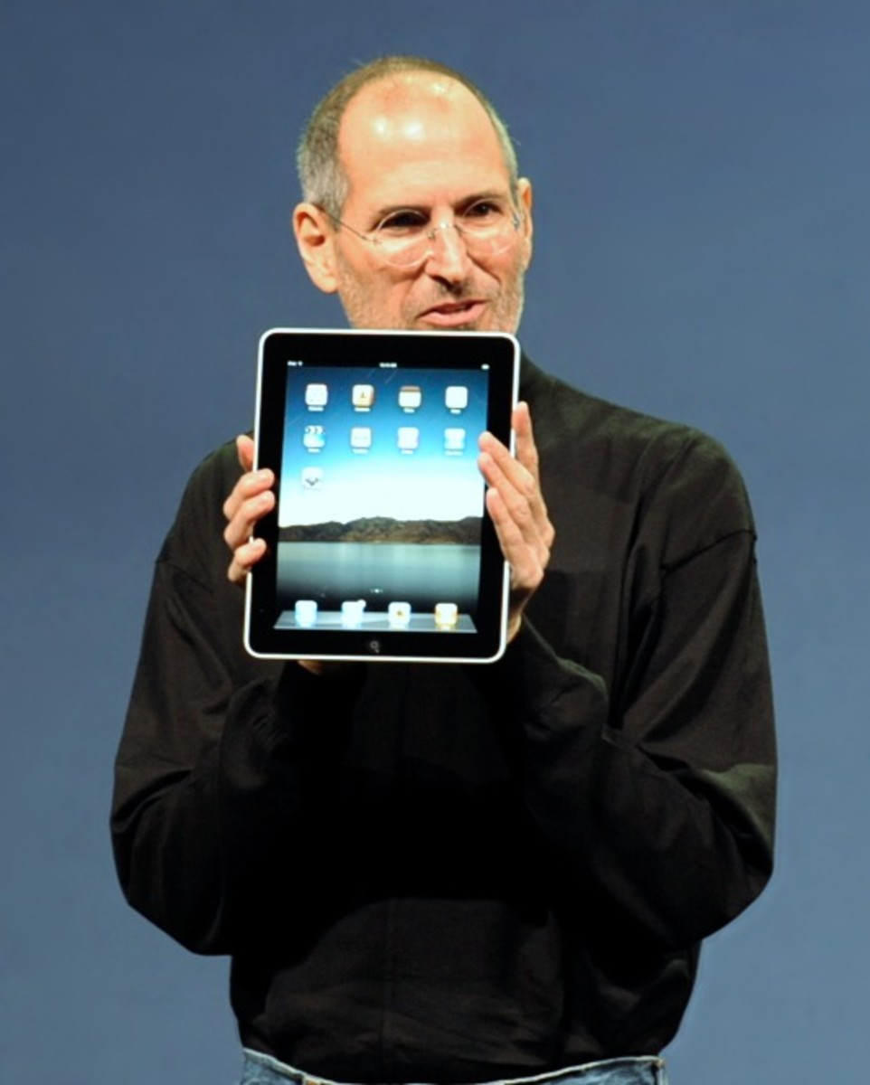 Steve Jobs holding the new iPad in 2010.