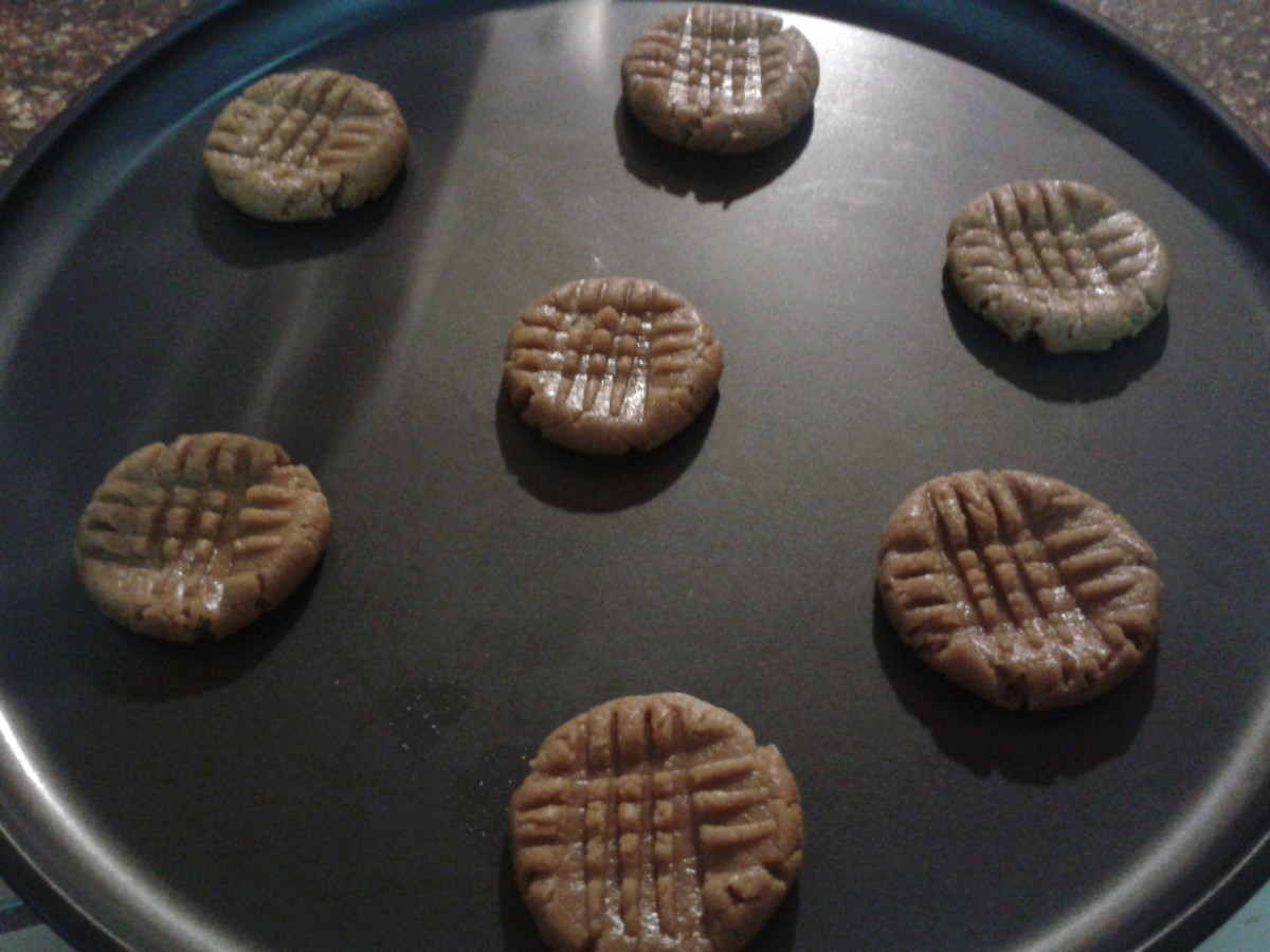 Press your cookies down with a fork to make a criss-cross pattern. This will help them bake evenly and quickly.