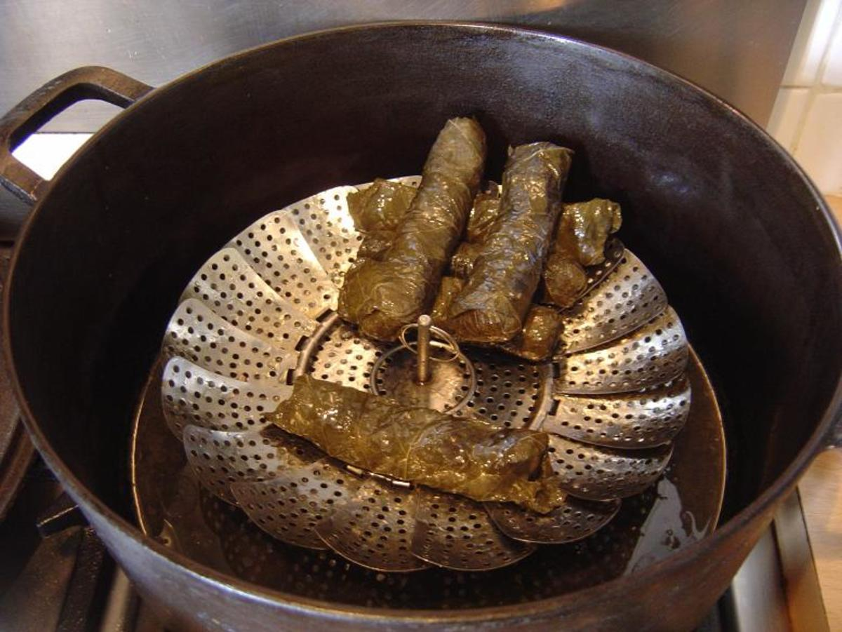 Alternatively, you can put them into a pan and stack them on a steamer. This way you can cook more vine leaves at one time - save energy and feed more people!