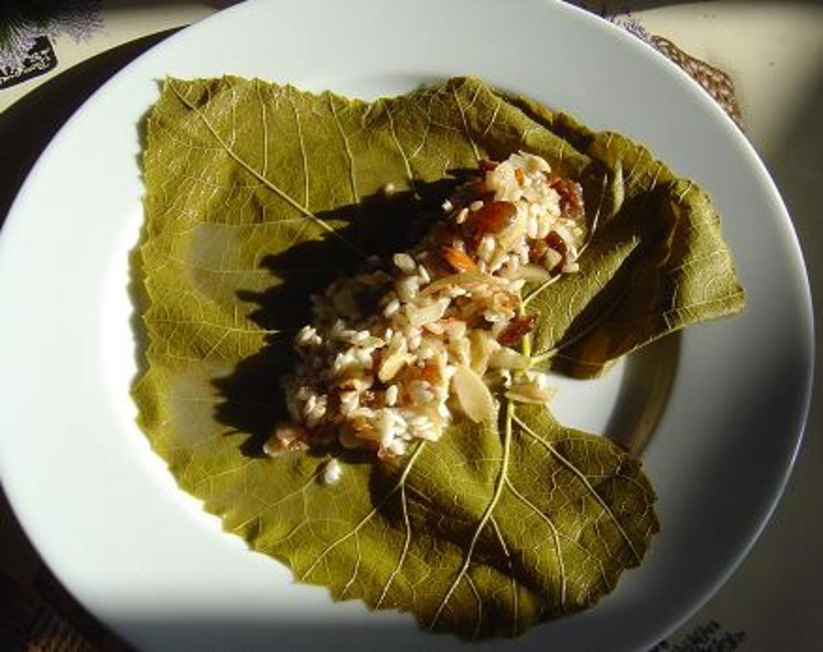 Put about this amount of the rice mixture onto the vine leaf and then fold the leaf quite tightly into a roll