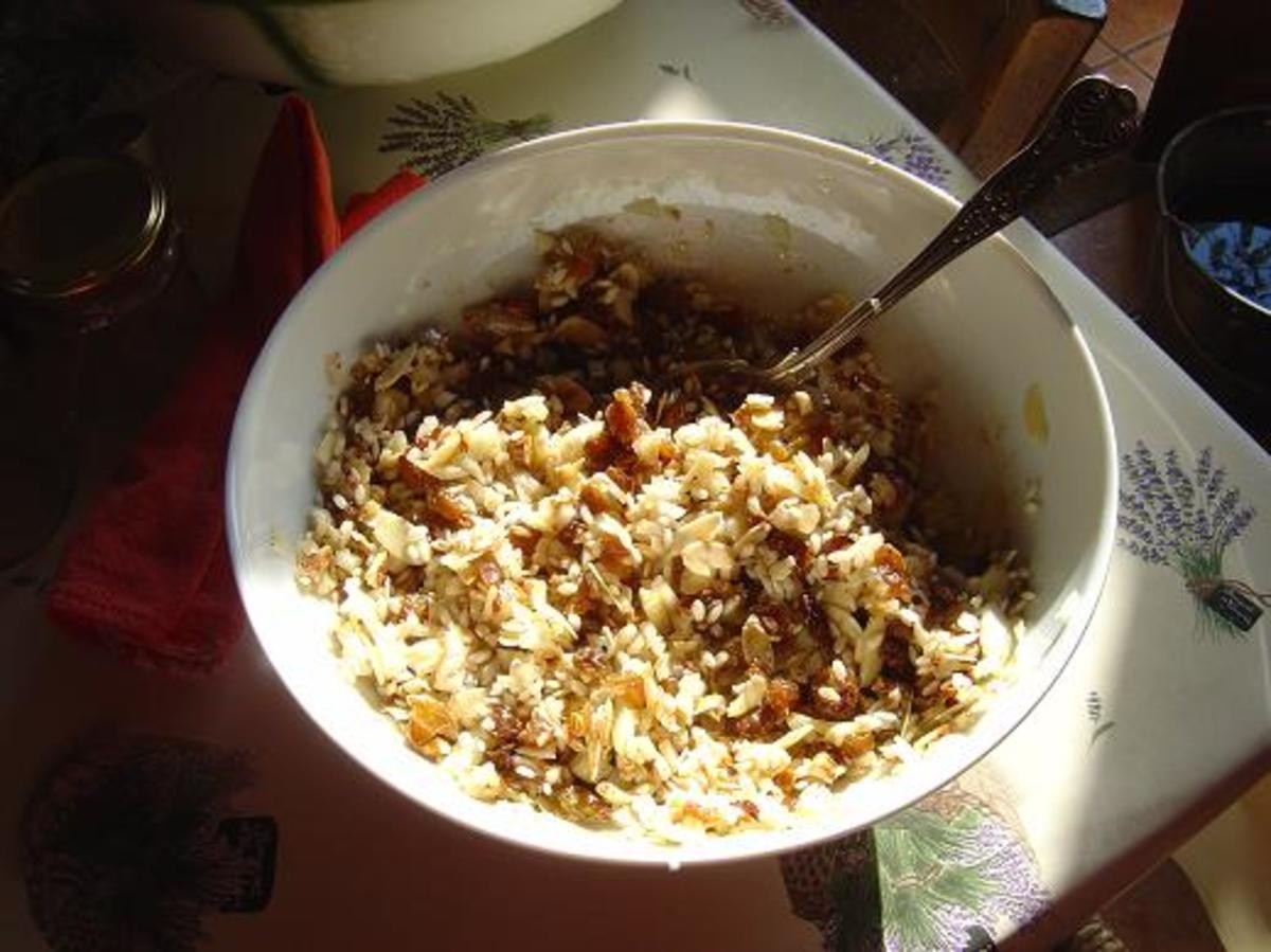 Rice, almonds, onions and raisins mixed together with the other ingredients