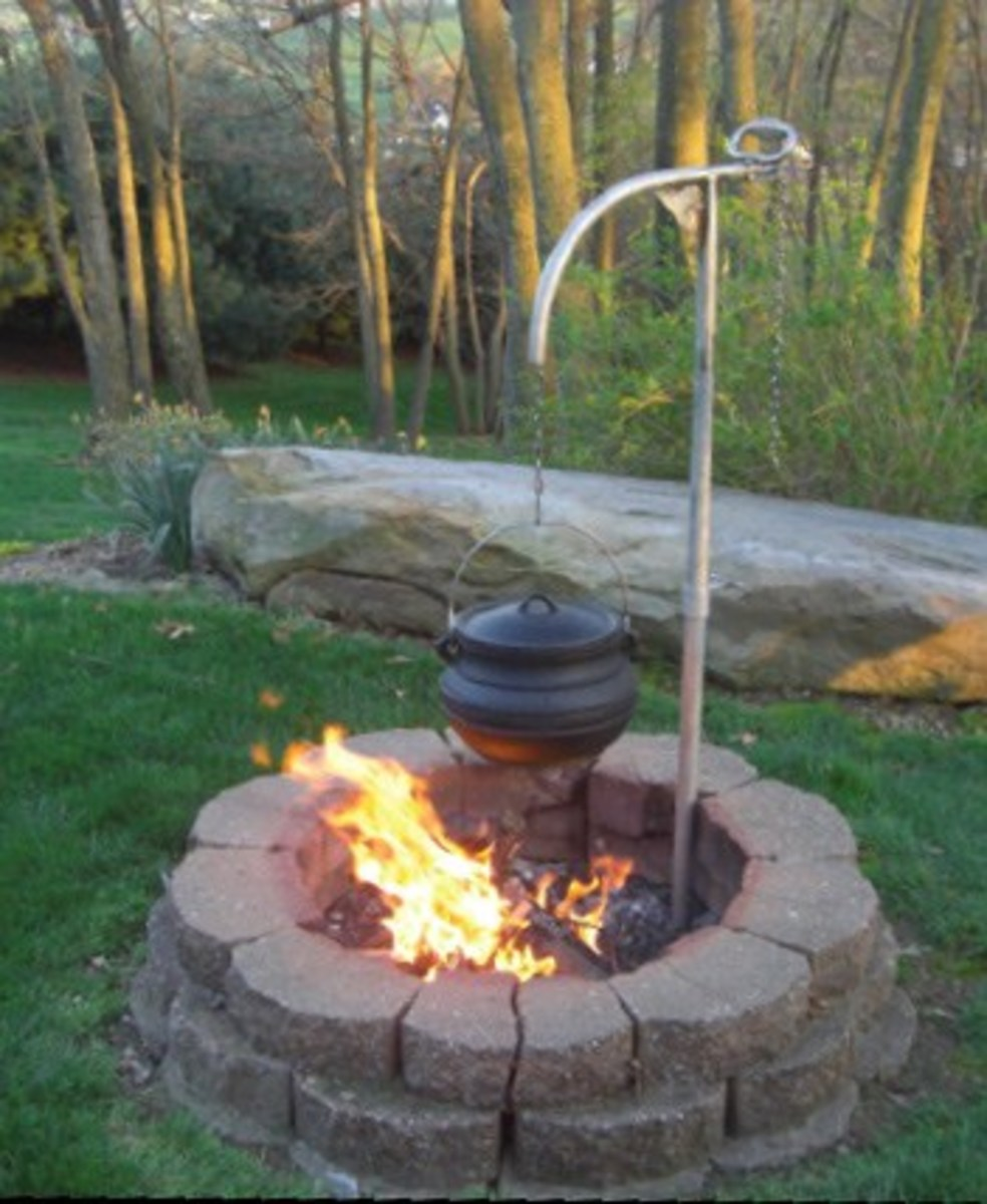 Outdoor cooking cast iron pots pans and fire pits.