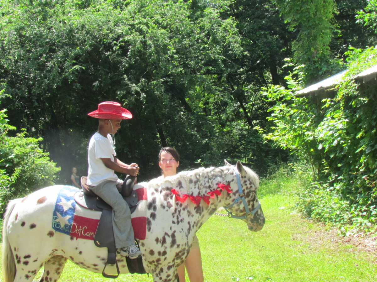 Delonte, one of Darlena's twin boys demonstrate his riding skills.