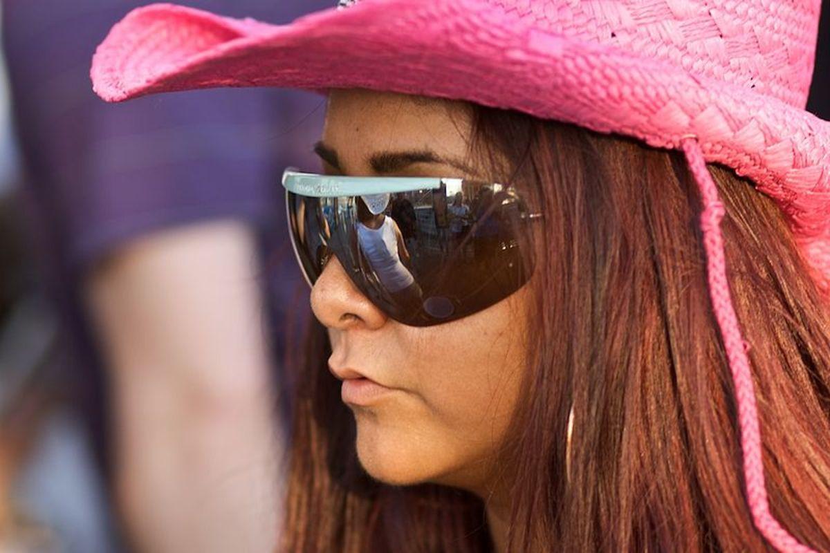 Snooki's hair under a pink hat
