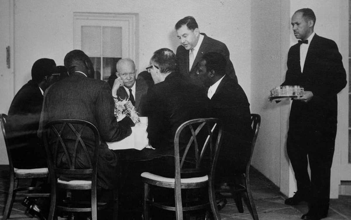 Dwight Eisenhower in discussion, Eugene at far right