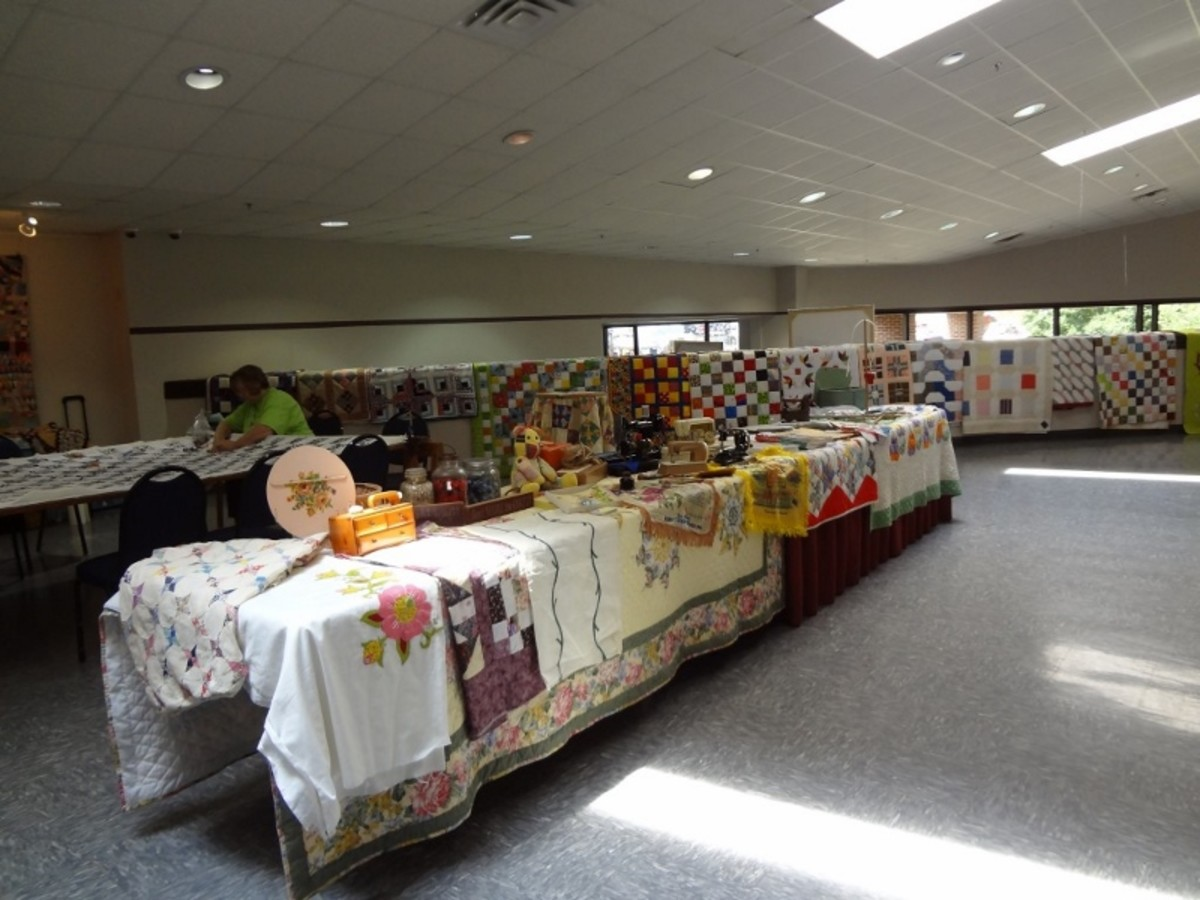 """Cindy"" is in charge of the event and made all these quilts. WOW! They are lined all around the room."