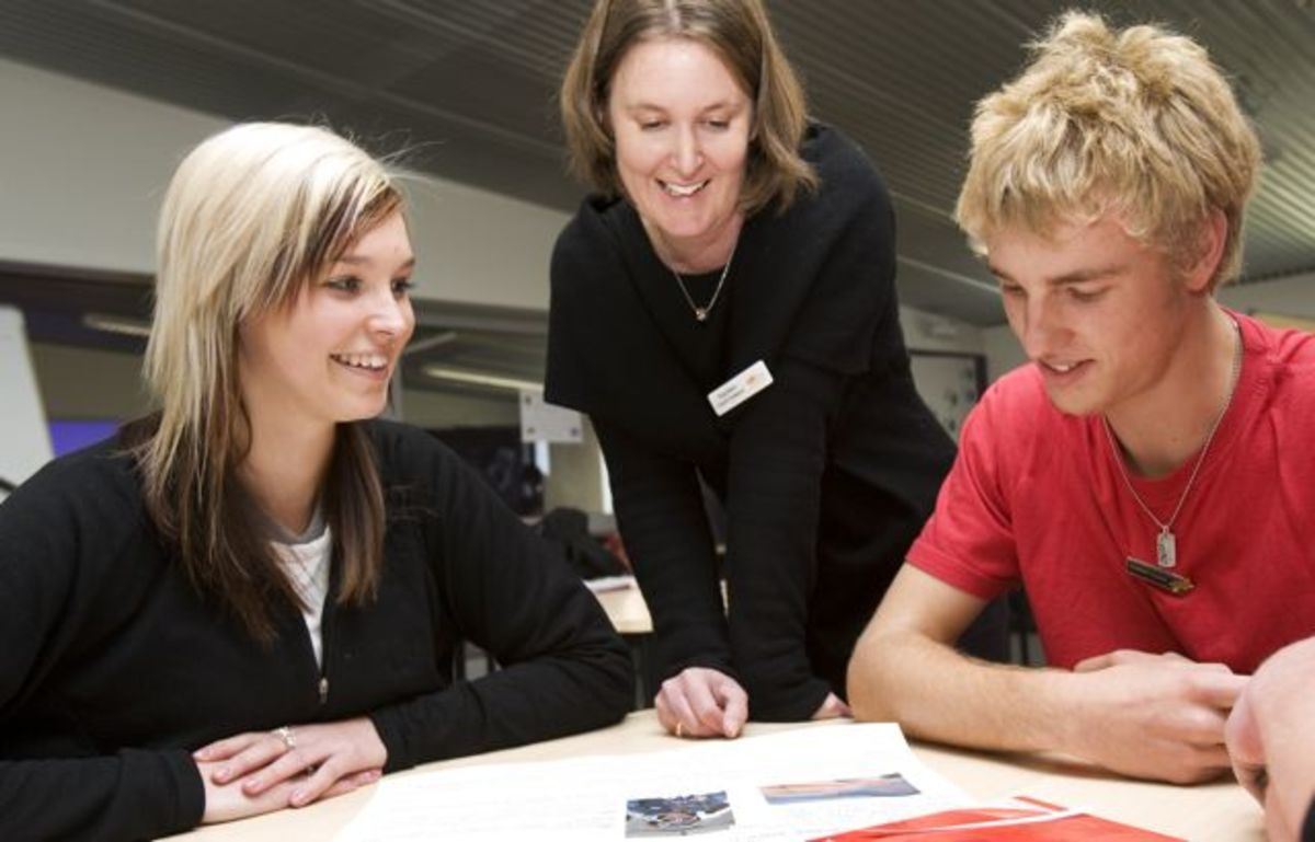 Students working with a teacher at Albany Senior High School, New Zealand.