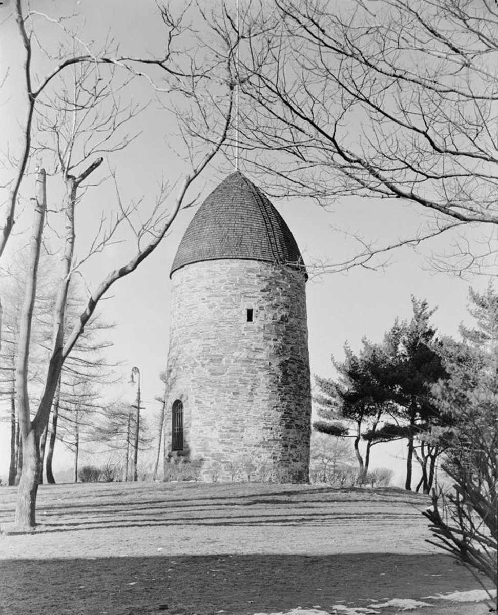 The Old Powder House in Somerville, Massachusetts, as it stood in 1935, atop the hill at Nathan Tufts Park overlooking Powder House Square.