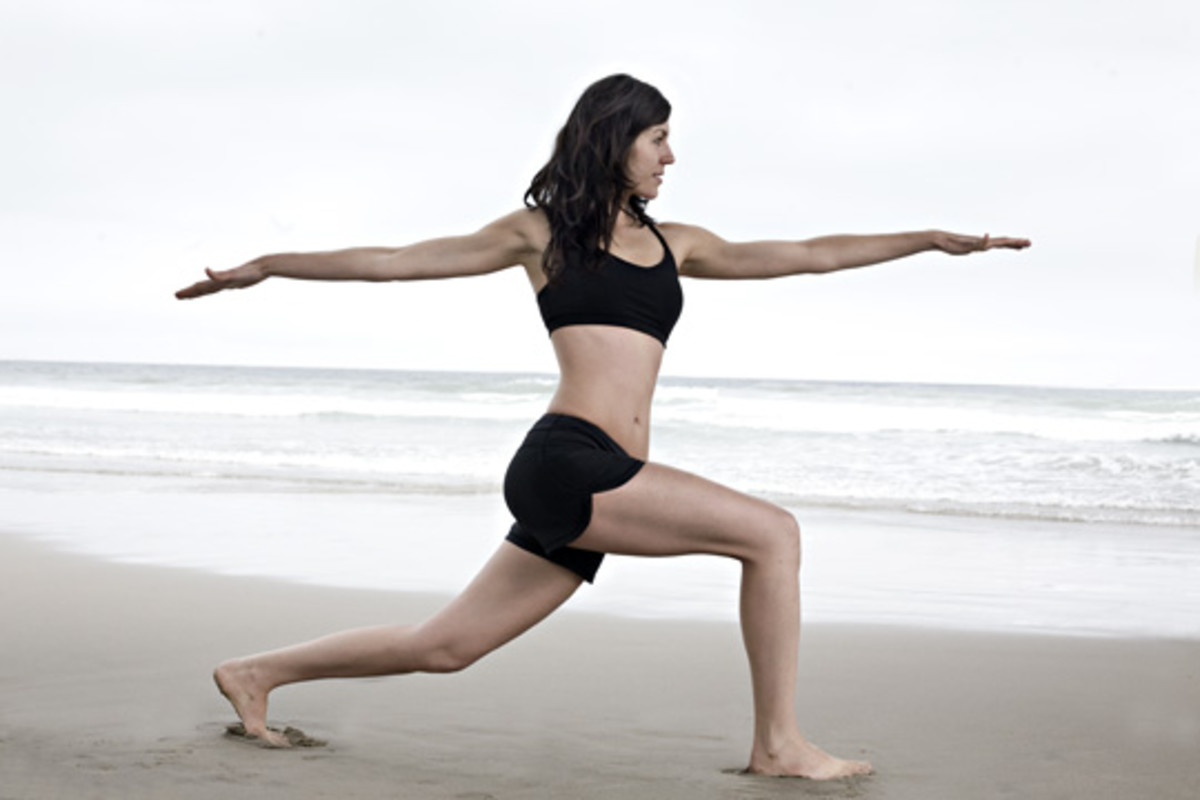 Woman exercising at the beach.