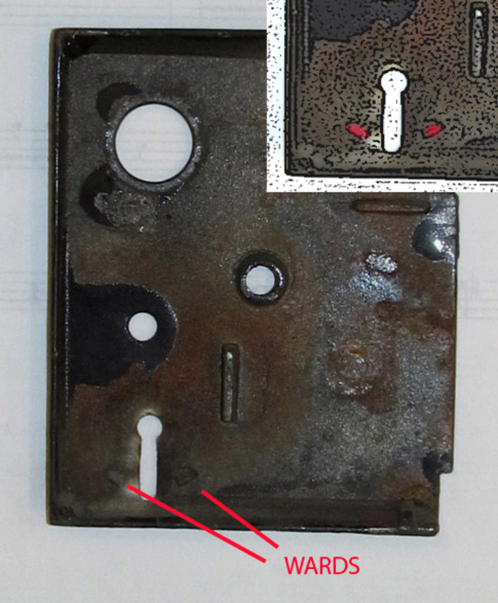 Interior side of lock case cover showing wards.  Inset shows wards in red for visibility.