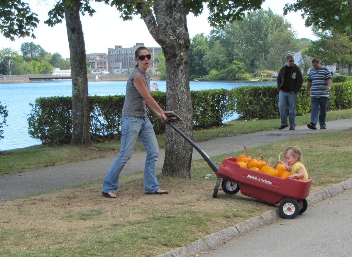 This mom and her child have their pumpkins. Soon they'll be making junk pumpkins.