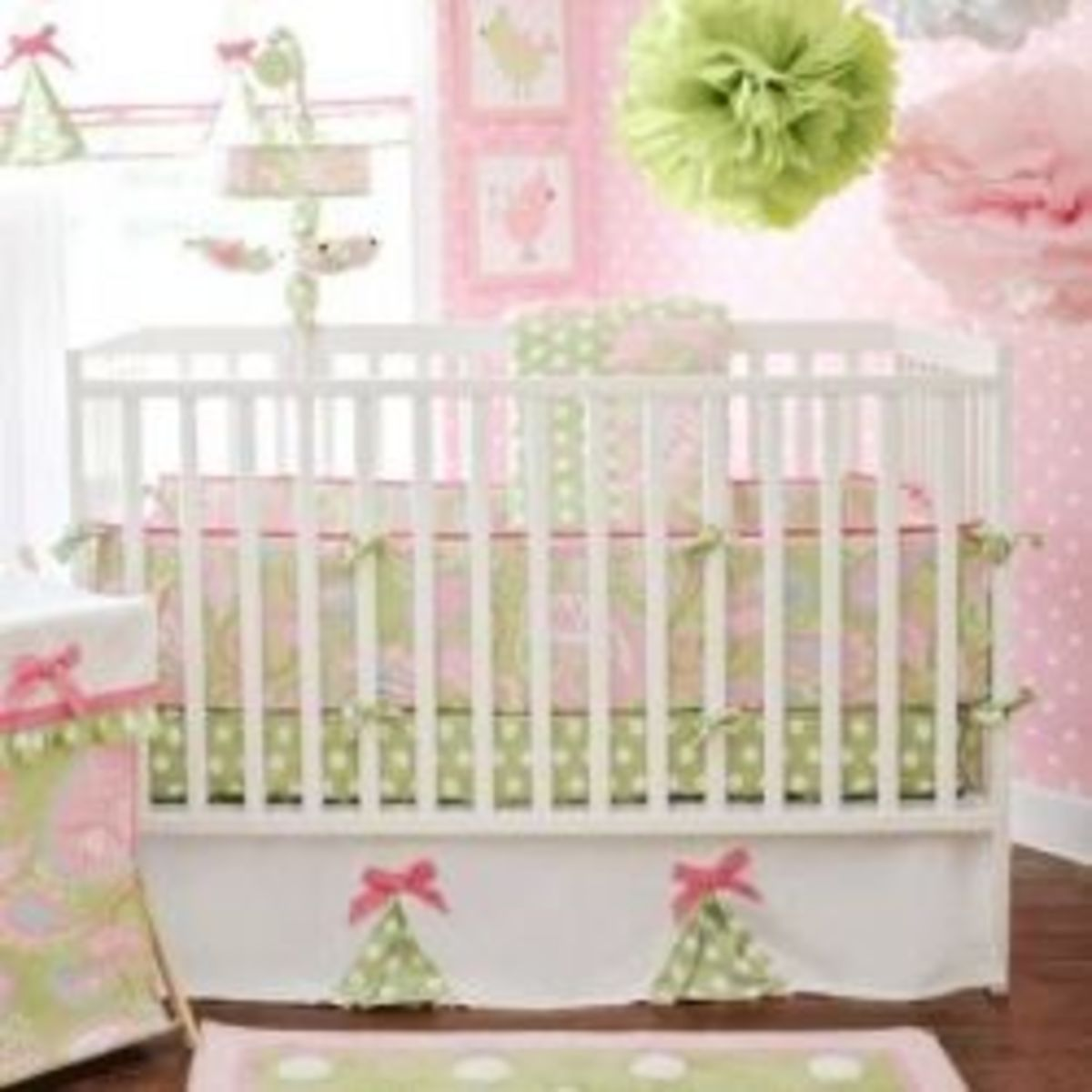 Image credit: Amazon.com. Baby Girl mini bedding crib set shown here and helpful, tissue paper pom pom how-to video is available below.