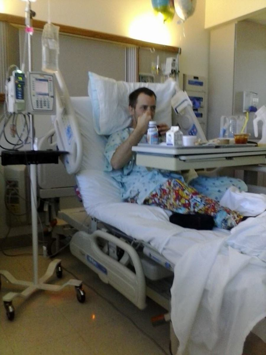 My husband a couple days after his operation. At least for a few nights we knew where we were sleeping!