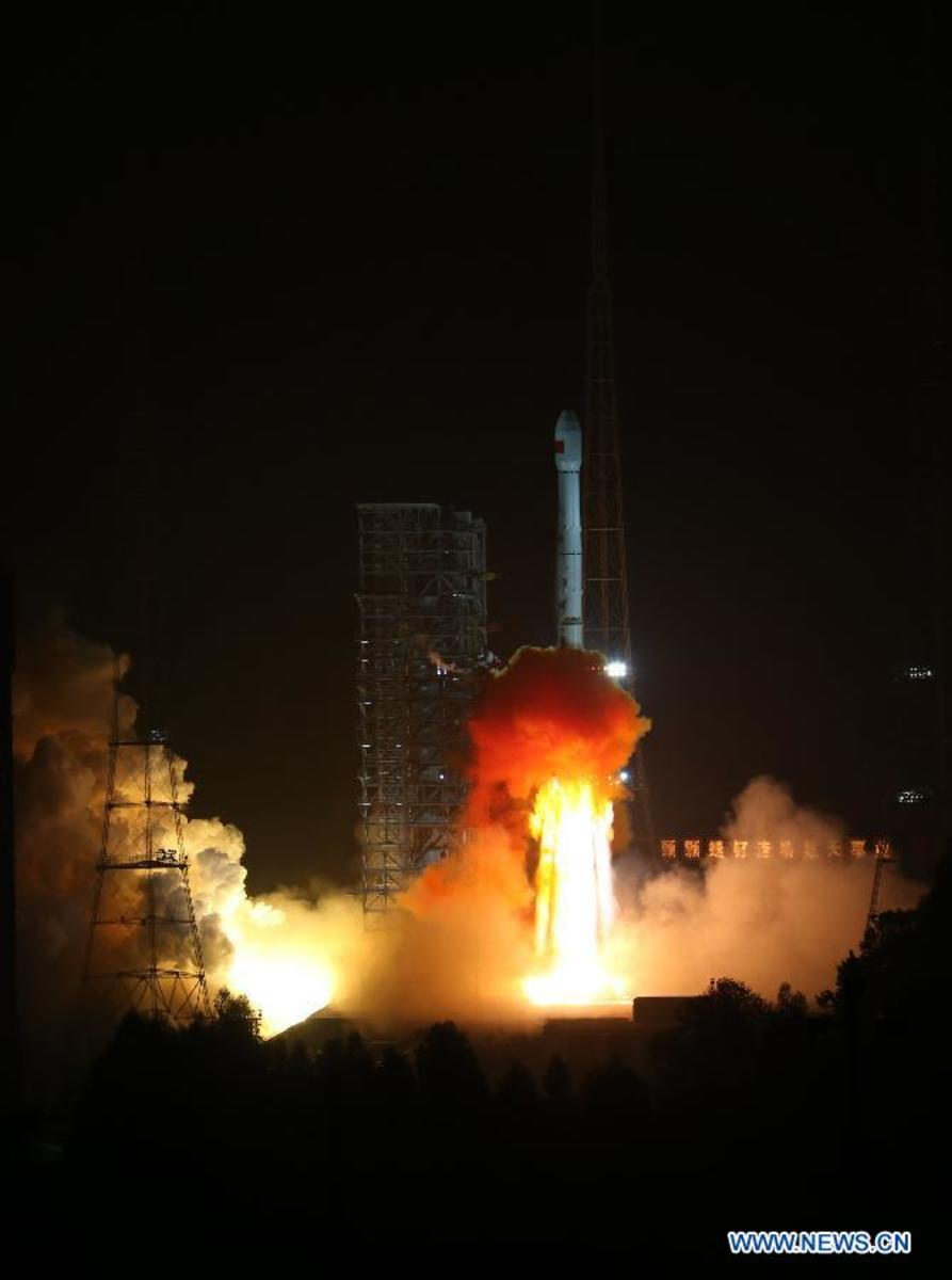 The Long March-3B carrier rocket carrying China's Chang'e-3 lunar probe blasts off from the launch pad at Xichang Satellite Launch Center.