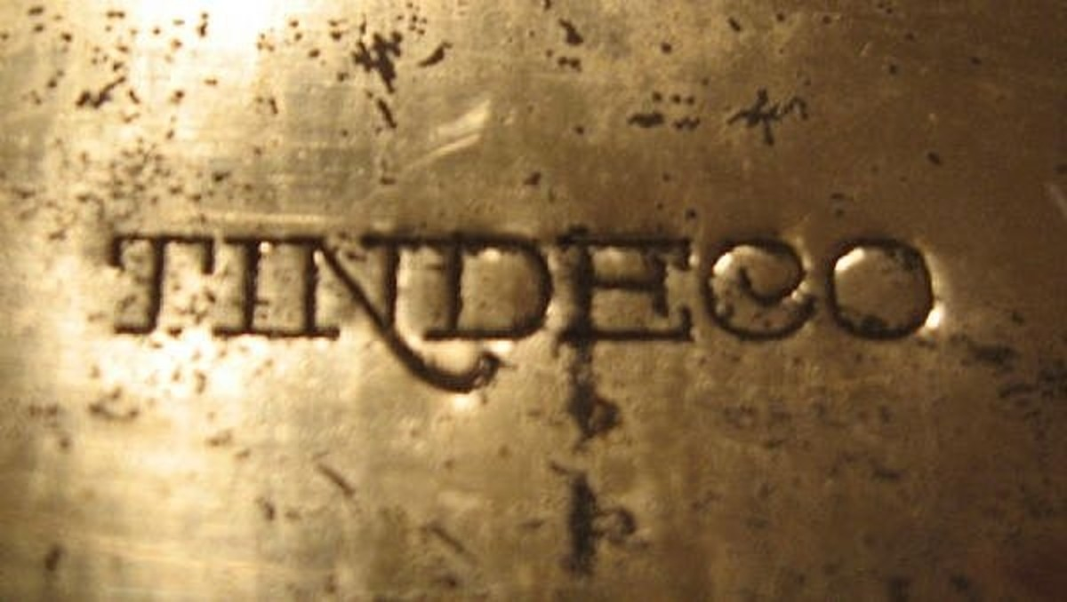 Tindeco tins usually have this marking on the bottom or sometimes on the rim.